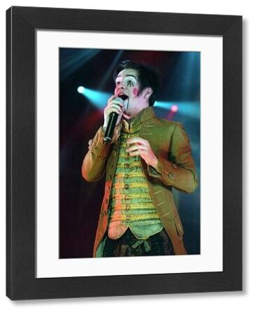 PANIC! AT THE DISCO SINGER BRENDON URIE PERFORMING AT THE LONG BEACH ARENA IN LONG BEACH, California - 6 December 2006 FAMOUS PICTURES AND FEATURES AGENCY 13 HARWOOD ROAD LONDON SW6 4QP UNITED KINGDOM tel 0 fax 0 e-mail FAM19356
