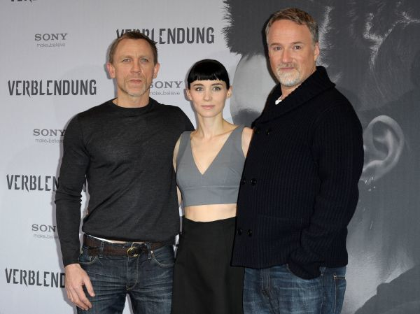 Daniel Craig, Rooney Mara and David Fincher at the photocall for 'The Girl with the Dragon Tattoo' in Berlin - 05 January 2012 FAMOUS  PICTURES AND FEATURES AGENCY  13 HARWOOD ROAD LONDON SW6 4QP  UNITED KINGDOM  tel 0  fax 0  e-mail    FAM43596