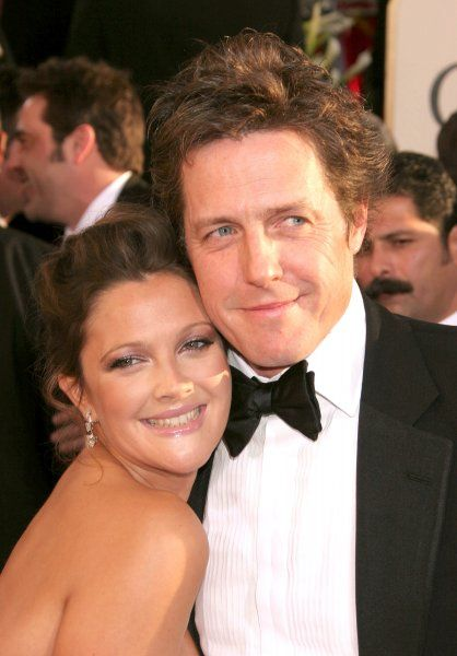 Drew Barrymore and Hugh Grant at the 64th Golden Globe Awards held at the Beverly Hilton Hotel in Los Angeles - 15 January 2007 FAMOUS PICTURES AND FEATURES AGENCY 13 HARWOOD ROAD LONDON SW6 4QP UNITED KINGDOM tel 0 fax 0 e-mail FAM19402