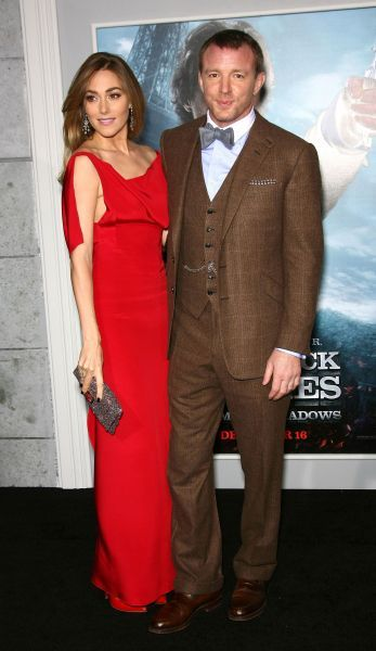 Jacqui Ainsley and Guy Ritchie at the premiere of 'Sherlock Holmes: A Game of Shadows' held at the Village Theater in Los Angeles - 06 December 2011 FAMOUS  PICTURES AND FEATURES AGENCY  13 HARWOOD ROAD LONDON SW6 4QP  UNITED KINGDOM  FAM43444