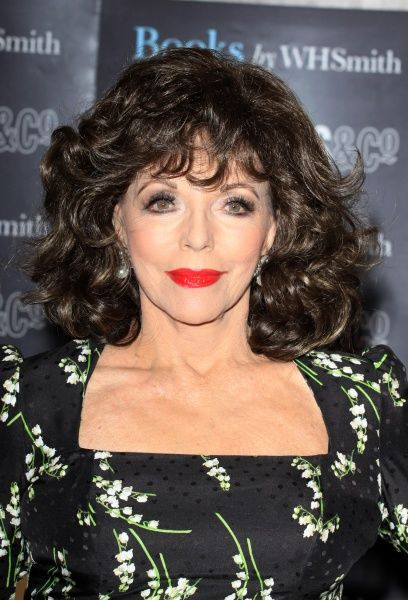 "Joan Collins at a signing of her book ""The World According to Joan"" at Selfridges in London - 10 March 2012 FAM44211"