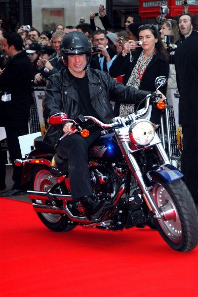 "John Travolta on a Harley Davidson at the UK Premiere of ""Wild Hogs"" at the Odeon West End, London - 28 March 2007 FAMOUS PICTURES AND FEATURES AGENCY 13 HARWOOD ROAD LONDON SW6 4QP UNITED KINGDOM tel +44 (0) 20 7731 9333 fax +44"
