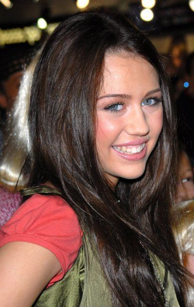 Miley Cyrus aka Hannah Montana (and daughter of country star Billy Ray Cyrus) at a signing of copies of the new Hannah Montana DVD at HMV in London - 27 March 2007 FAMOUS PICTURES AND FEATURES AGENCY 13 HARWOOD ROAD LONDON SW6 4QP UNITED KINGDOM tel +44