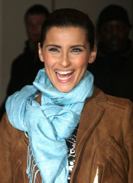 Nelly Furtado at the MTV studios in New York City for TRL - 19 March 2007 FAMOUS PICTURES AND FEATURES AGENCY 13 HARWOOD ROAD LONDON SW6 4QP UNITED KINGDOM tel +44 (0) 20 7731 9333 fax +44 (0) 20 7731 9330 e-mail info@famous.uk.com www.famous