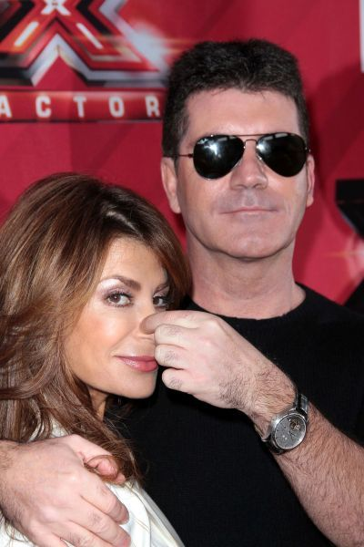 Paula Abdul and Simon Cowell at The X Factor press conference in Los Angeles - 19 December 2011 FAMOUS  PICTURES AND FEATURES AGENCY  13 HARWOOD ROAD LONDON SW6 4QP  UNITED KINGDOM  FAM43570