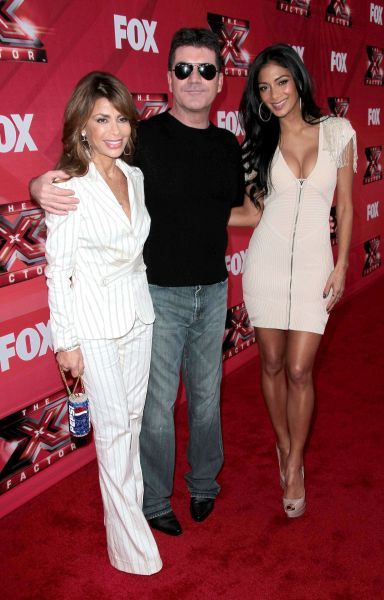 Paula Abdul, Simon Cowell and Nicole Scherzinger at The X Factor press conference in Los Angeles - 19 December 2011 FAMOUS  PICTURES AND FEATURES AGENCY  13 HARWOOD ROAD LONDON SW6 4QP  UNITED KINGDOM  tel 0  fax 0  e-mail    FAM43570