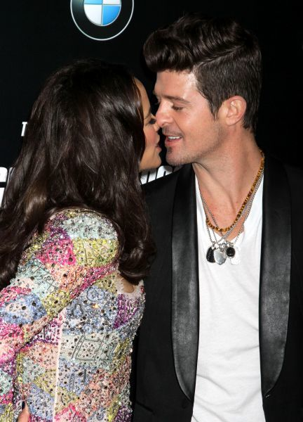 Paula Patton and Robin Thicke at the premiere of 'Mission: Impossible - Ghost Protocol' at the Ziegfeld Theatre in New York City - 19 December 2011  FAMOUS PICTURES AND FEATURES AGENCY 13 HARWOOD ROAD LONDON SW6 4QP UNITED KINGDOM tel 0 fax 0 e-mail