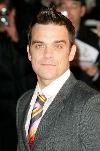 Robbie Williams at the NRJ Music Awards in Cannes - 21 January 2006 FAMOUS PICTURES AND FEATURES AGENCY 13 HARWOOD ROAD LONDON SW6 4QP UNITED KINGDOM tel 0 fax 0 e-mail FAM16866